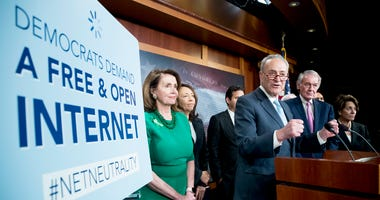 Senate Minority Leader Sen. Chuck Schumer of N.Y., accompanied by House Minority Leader Nancy Pelosi of Calif., left, Sen. Maria Cantwell, D-Wash., second from left, Sen. Ed Markey, D-Mass., and Rep. Rep. Anna Eshoo, D-Calif., right, and other Democratic