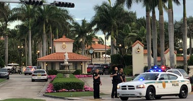 Police respond to The Trump National Doral resort after reports of a shooting inside the resort Friday, May 18, 2018 in Doral, Fla. A man shouting about Donald Trump entered the president's south Florida golf course early Friday, draped a flag over a lobb