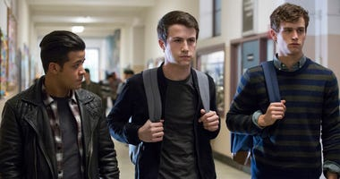 "This image released by Netflix shows, from left, Christian Navarro, Dylan Minnette and Brandon Flynn in ""13 Reasons Why."" Netflix has canceled the premiere of its second season of the teen drama ""13 Reasons Why"" because of Friday's school shooting near Ho"