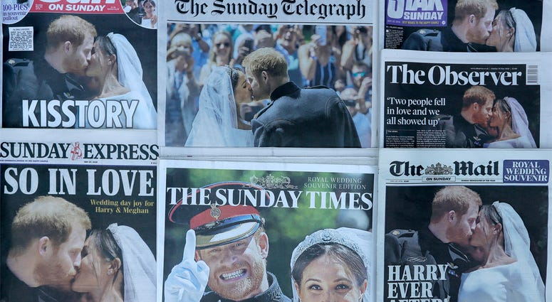 A photo illustration showing a selection of British Newspaper front pages with pictures from the wedding of Britain's Prince Harry and Meghan Markle, in London, Sunday, May 20, 2018. (AP Photo/Kirsty Wigglesworth)