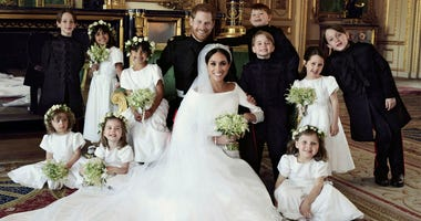 In this photo released by Kensington Palace on Monday May 21, 2018, shows an official wedding photo of Britain's Prince Harry and Meghan Markle, center, in Windsor Castle, Windsor, England, Saturday May 19, 2018. Others in photo from left, back row, Brian