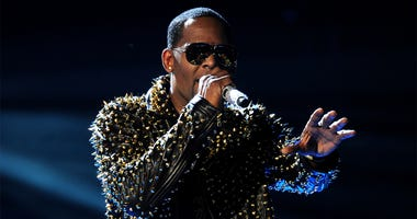 In this June 30, 2013, file photo, R. Kelly performs onstage at the BET Awards at the Nokia Theatre in Los Angeles. A woman filed a lawsuit Monday, May 21, 2018, in New York against R. Kelly, claiming the singer sexually assaulted her. He has long been th