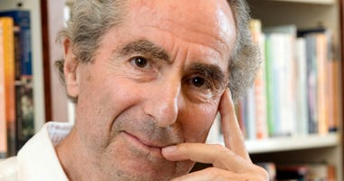 In this Sept. 8, 2008, file photo, author Philip Roth poses for a photo in the offices of his publisher, Houghton Mifflin, in New York. Roth, prize-winning novelist and fearless narrator of sex, religion and mortality, has died at age 85, his literary age
