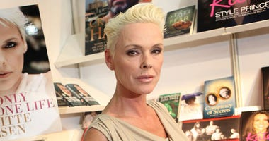 """In this April 11, 2011 file photo, actress Brigitte Nielsen launches her autobiography, """"You Only Get One Life"""", at the London Book Fair, Earl's Court Exhibition Centre, London. Nielsen is pregnant with her fifth child. The actress posted photos of her ba"""