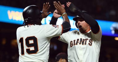 San Francisco Giants' Joe Panik, right, celebrates with Alen Hanson (19) after both scored against the Arizona Diamondbacks in the fourth inning of a baseball game Monday, June 4, 2018, in San Francisco. Both scored on a double by Giants' Buster Posey. (A