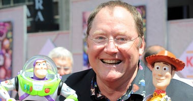 "In this June 13, 2010 file photo, John Lasseter arrives at the world premiere of ""Toy Story 3,"" at The El Capitan Theater in Los Angeles. John Lasseter, the co-founder of Pixar Animation Studios and the Walt Disney Co.'s animation chief, will step down at"