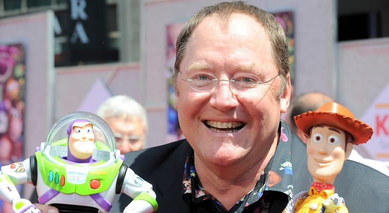 """In this June 13, 2010 file photo, John Lasseter arrives at the world premiere of """"Toy Story 3,"""" at The El Capitan Theater in Los Angeles. John Lasseter, the co-founder of Pixar Animation Studios and the Walt Disney Co.'s animation chief, will step down at"""