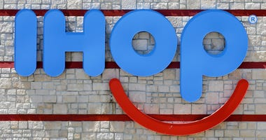 """This May 11, 2017, file photo shows an IHOP sign at a restaurant in Hialeah, Fla. IHOP, which teased a name change to IHOb earlier this month, says the """"b"""" is to promote its burger menu. The pancake restaurant has been coy about whether the name change is"""
