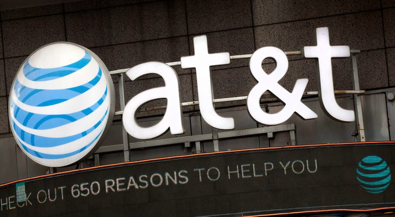 In this Monday, Oct. 24, 2016, file photo, the AT&T logo is positioned above one of its retail stores, in New York. The fate of the AT&T-Time Warner merger, a massive media deal opposed by the government that could shape how much consumers pay for streami