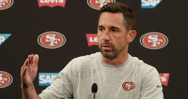 San Francisco 49ers head coach Kyle Shanahan speaks to reporters before an NFL football practice at the team's headquarters in Santa Clara, Calif., Wednesday, June 13, 2018. Year one under coach Kyle Shanahan was a bit of a whirlwind for the 49ers with ne