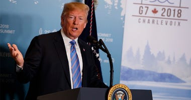 In this June 9, 2018 file photo, President Donald Trump speaks during a news conference at the G-7 summit in La Malbaie, Quebec, Canada. New York Attorney General sues the Trump Foundation, Thursday, June 14, saying it engaged in a pattern of illegal self