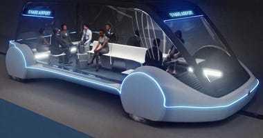 This undated artist's rendering provided by The Boring Company, shows an electric public transportation vehicle that is part of a proposed high-speed underground transportation system that will transport passengers from downtown Chicago to O'Hare Internat