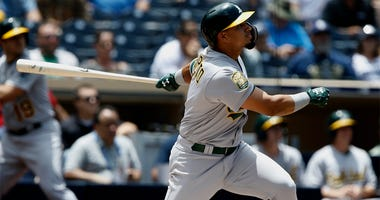 Oakland Athletics' Franklin Barreto follows through to hit a three-run home run during the second inning of a baseball game against the San Diego Padres in San Diego, Wednesday, June 20, 2018.