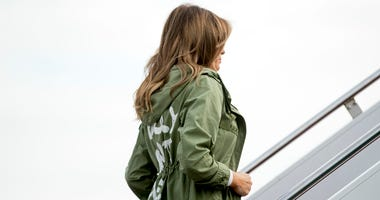 First lady Melania Trump boards a plane at Andrews Air Force Base, Md., Thursday, June 21, 2018, to travel to Texas. (AP Photo/Andrew Harnik)