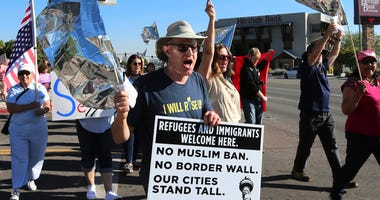 Bob Fulkerson leads protestors up the street to the Peppermill Resort-Casino in Reno, Nev., as Attorney General Jeff Sessions delivers remarks on immigration to NASRO, a School Safety Conference, Monday, June 25, 2018.