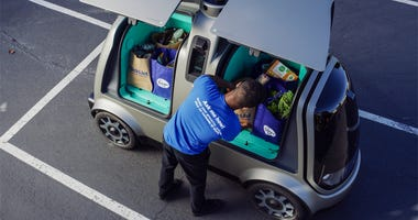This undated photo provided by The Kroger Co. shows a driverless car that the Cincinnati-based company is about to test whether it can steer supermarket customers away from crowded grocery aisles with a fleet of diminutive driverless cars designed to lowe