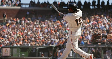 San Francisco Giants' Alen Hanson follows through on a two-run double to shallow right field off Colorado Rockies relief pitcher Adam Ottavino in the eighth inning of a baseball game Thursday, June 28, 2018, in San Francisco. (AP Photo/Eric Risberg)