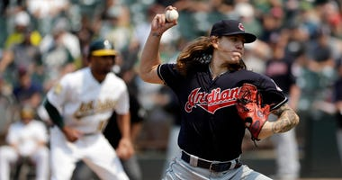Cleveland Indians starting pitcher Mike Clevinger throws to the Oakland Athletics during the seventh inning of a baseball game Sunday, July 1, 2018, in Oakland, Calif.