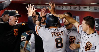 San Francisco Giants' Hunter Pence (8) celebrates his run scored against the Arizona Diamondbacks with assistant hitting coach Rick Schu, left, Austin Slater, second from right, and Nick Hundley, right, during the fifth inning of a baseball game Sunday, J