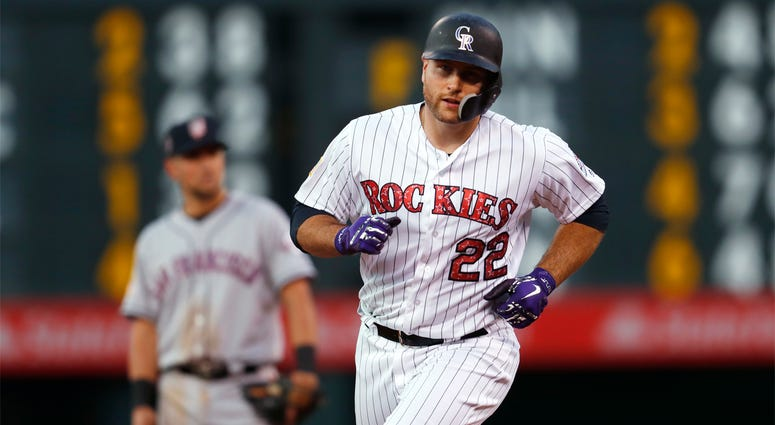 Colorado Rockies' Chris Iannetta circles the bases after hitting a solo home run off San Francisco Giants starting pitcher Andrew Suarez during the seventh inning of a baseball game Wednesday, July 4, 2018, in Denver. (AP Photo/David Zalubowski)