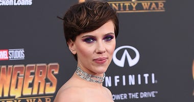 """In this April 23, 2018 file photo, Scarlett Johansson arrives at the world premiere of """"Avengers: Infinity War"""" in Los Angeles. Johansson's plans to portray a transgender man has sparked a backlash from many who object to cisgender actors playing trans ro"""