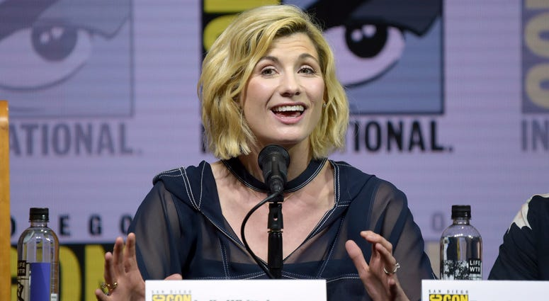 """Jodie Whittaker speaks at the """"Doctor Who"""" panel on day one of Comic-Con International on Thursday, July 19, 2018, in San Diego.(Photo by Richard Shotwell/Invision/AP)"""