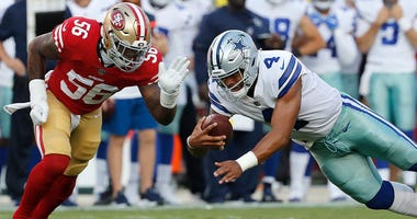 Dallas Cowboys quarterback Dak Prescott (4) dives in front of San Francisco 49ers linebacker Reuben Foster (56) during the first half of an NFL preseason football game in Santa Clara, Calif., Thursday, Aug. 9, 2018. (AP Photo/Josie Lepe)