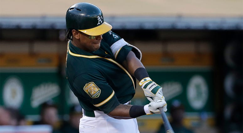 In this Aug. 4, 2018 file photo, Oakland Athletics' Khris Davis hits a solo home run against the Detroit Tigers during the third inning of a baseball game in Oakland, Calif. Davis has certainly contemplated the idea of hitting 50 home runs. The Oakland sl