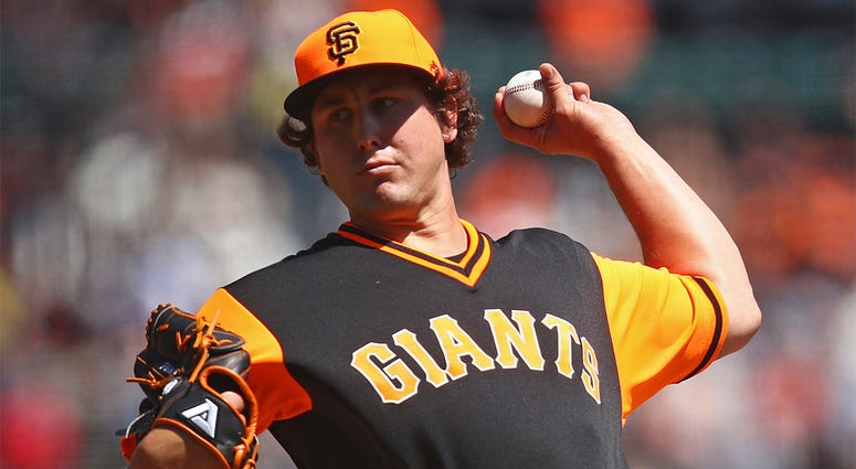 San Francisco Giants pitcher Derek Holland works against the Texas Rangers in the first inning of a baseball game Sunday, Aug. 26, 2018, in San Francisco. (AP Photo/Ben Margot)