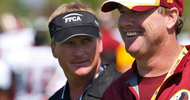 "In this July 25, 2014, file photo, ESPN broadcaster and former NFL coach Jon Gruden, left, walks with his brother, Washington Redskins head coach Jay Gruden, after practice at the team's NFL football training facility in Richmond, Va. With Jon leaving ""Mo"
