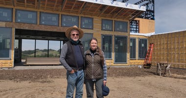 Howard and Merritt Booster stand in front of their new home being built in Santa Rosa where their previous house was destroyed by the 2017 Tubbs Fire.