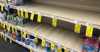 Empty sanitizer shelves at Peninsula CVS store