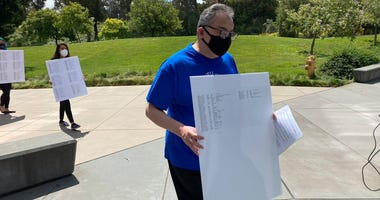 Union reps deliver a petition of over 1,000 signatures to CSU East Bay administrators.
