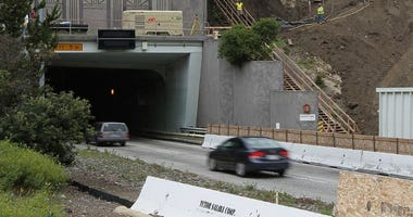 : Traffic moves by a construction site at the Caldecott Tunnel fourth bore project June 3, 2010 in Orinda, California.