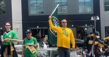 Oakland Athletics fans showed up at a vote by the Port of Oakland that offered initial approval to the plans for a new stadium near at Howard Terminal.