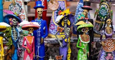 Day of the Dead is a Mexican holiday, increasingly celebrated in the U.S., in which family and friends gather to pray for and remember friends and family members who have died, paying homage to their spiritual journey.