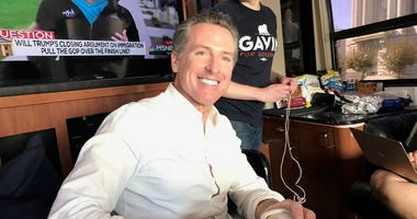 Gavin Newsom rides through California on a bus tour as part of his campaign for goernor.