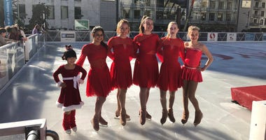 Young skaters celebrate the opening of the Union Square ice-skating rink on Nov. 7, 2018.