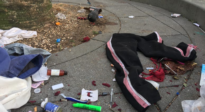 Garbage, including a discarded needle, piles up in Embarcadero Plaza on June 10, 2019.
