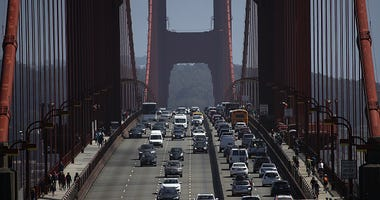 Cars drive over the Golden Gate Bridge