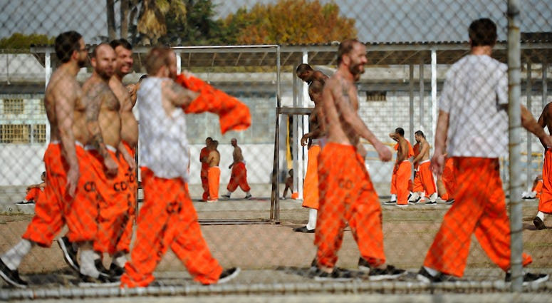 Inmates at Chino State Prison exercise in the yard December 10, 2010 in Chino.