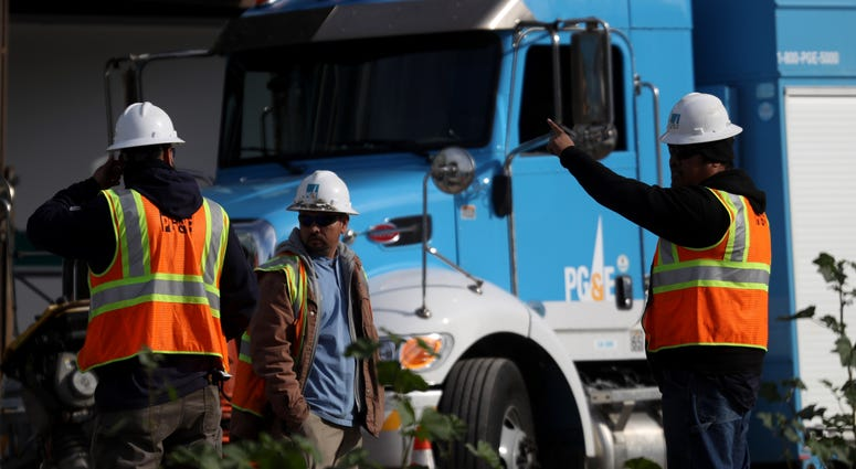 Pacific Gas and Electric (PG&E) workers remain at the scene of a three-alarm fire that started after a construction crew hit a gas line on February 07, 2019 in San Francisco, California.