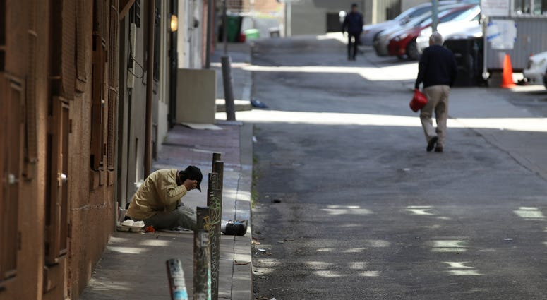 A homeless man sits on the sidewalk on May 17, 2019 in San Francisco.