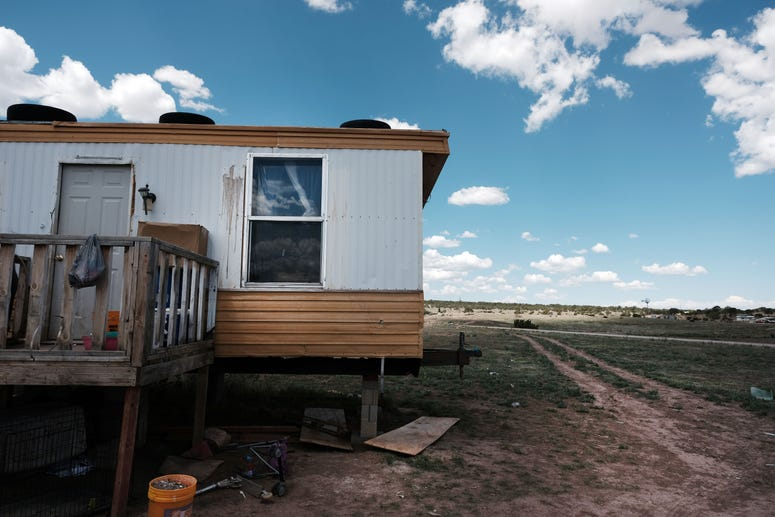 THOREAU, NEW MEXICO - JUNE 06: A trailer stands on land belonging to members of the Navajo Nation in the town of Thoreau on June 06, 2019 in Thoreau, New Mexico.