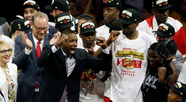 Toronto Raptors President Masai Ujiri celebrates with players after the team defeated the Golden State Warriors to win the NBA Finals on June 13, 2019.