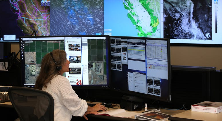 Pacific Gas and Electric (PG&E) Senior Wildfire Operations Center Analyst Sarah Gibson monitors weather and satellite images of fire areas at the PG&E Wildfire Safety Operations Center on August 05, 2019 in San Francisco, California.