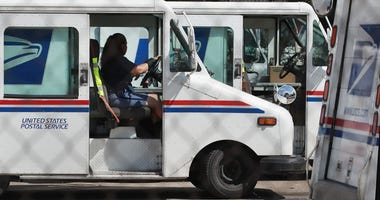 A United States Postal Service (USPS) worker leaves a postal facility on August 15, 2019 in Chicago, Illinois.