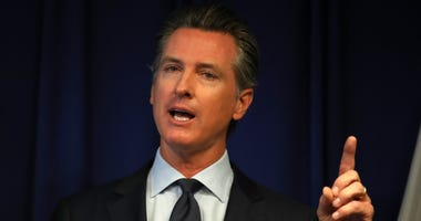 Gov. Gavin Newsom speaks during a news conference at the California justice department on September 18, 2019 in Sacramento.