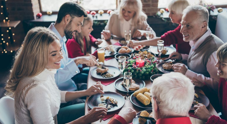 A family eats a meal during the holidays.