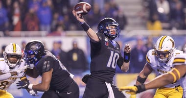 Quarterback Chase Cord #10 of the Boise State Broncos passes during the second half against the Wyoming Cowboys on November 9, 2019 at Albertsons Stadium in Boise, Idaho.